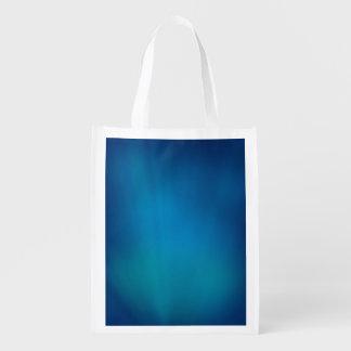 Tiefes blaues Unterwasserglühen Wiederverwendbare Einkaufstasche