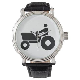 Traktor, der Zeichen bewirtschaftet Uhren
