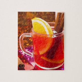 Transparente Tasse Tee mit Zitrusfrucht und Zimt Puzzle