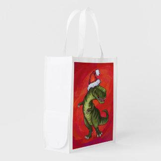 TRex Dino in der Weihnachtsmannmütze auf Rot Wiederverwendbare Einkaufstasche