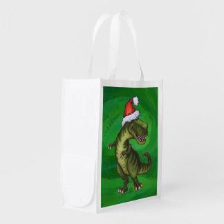 TRex in der Weihnachtsmannmütze auf Grün Wiederverwendbare Einkaufstasche