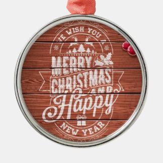 Typografie der frohen Weihnachten und des guten Rundes Silberfarbenes Ornament