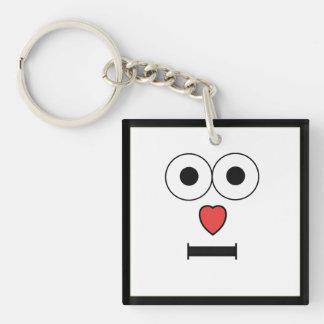 Überraschtes Gesicht mit Herz-Nase Schlüsselanhänger