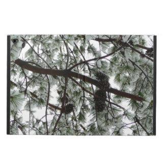 Unter den Schnee bedeckt Kiefern-Baum-Winter-Foto