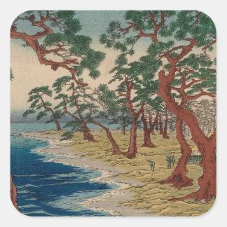 Verdrehte Bäume durch das Ufer Quadratischer Aufkleber