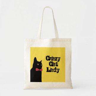 Verrückte Katzen-Dame - schwarze Katze mit roter Tragetasche