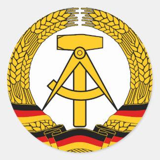 Versinnbildlichen Sie der DDR - nationales Emblem Runder Aufkleber