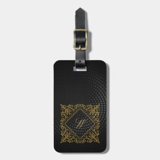 Verziertes Diamant-Monogramm auf schwarzem Kofferanhänger