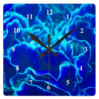 Vibrierende blaue und aquamarine quadratische wanduhr