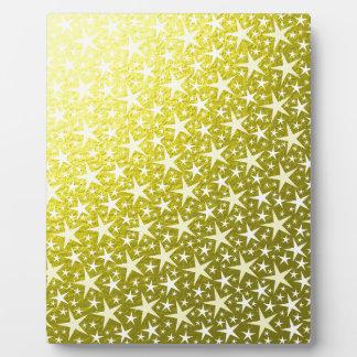 viele kleinen Sterne in einem goldenen Hintergrund Fotoplatte