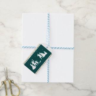Vintage frohe Weihnachten mit blauem Hintergrund Geschenkanhänger