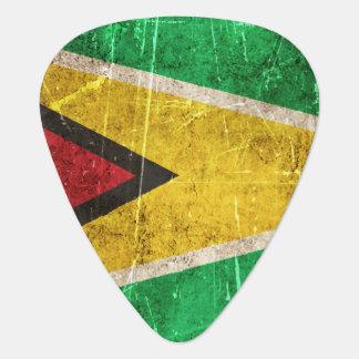 Vintage gealterte und verkratzte Flagge von Guyana Plektron