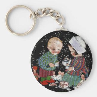 Vintage Kinder, die ein vortäuschentee-Party haben Schlüsselanhänger