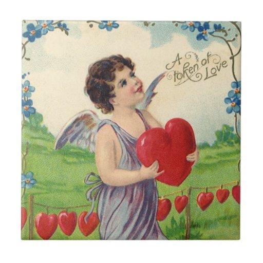 Vintage Valentines-viktorianischer Amor, der ein Kachel