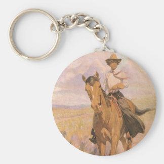 Vintager Cowgirl-Cowboy, Frau auf Pferd durch Schlüsselanhänger
