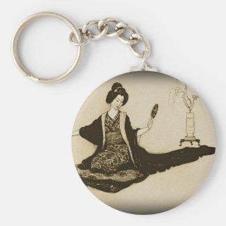 Vintager Sepia japanischer Geisha, der mit Spiegel Schlüsselanhänger