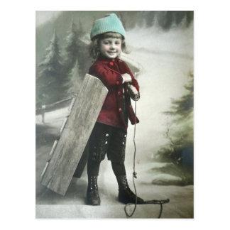 Vintager viktorianischer Junge mit a-Schlitten Postkarten