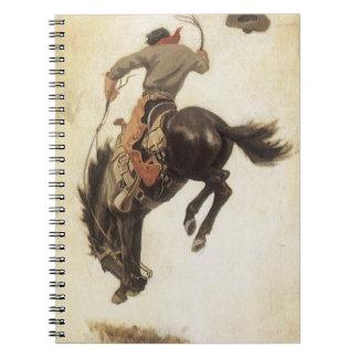 Vintager Western, Cowboy auf einem sträubenden Spiral Notizblock