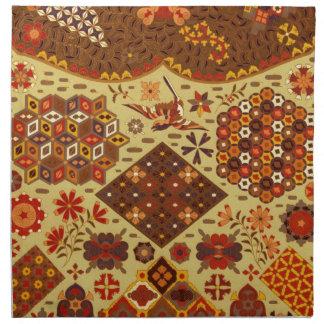 Vintages Patchwork mit Blumen - in den Herbst-Farb Stoffserviette
