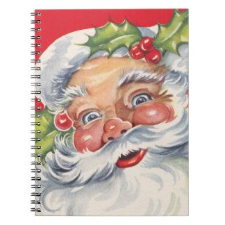 Vintages Weihnachten, lustiger Weihnachtsmann mit Spiral Notizblock