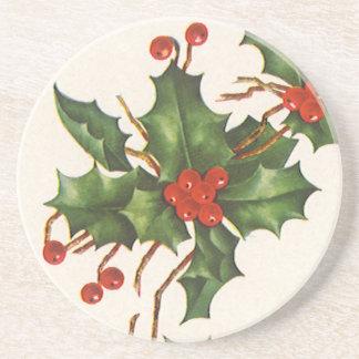 Vintages Weihnachten, Stechpalmen-Pflanze mit Getränkeuntersetzer