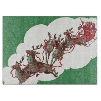 Vintages Weihnachtsabend, Retro Weihnachtsmann im Schneidebrett