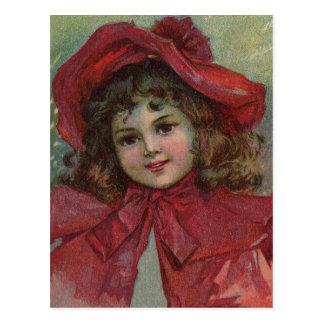Vintages Weihnachtskind mit rotem viktorianischem Postkarte