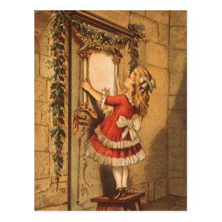 Vintages Weihnachtsviktorianisches Mädchen, das Postkarte
