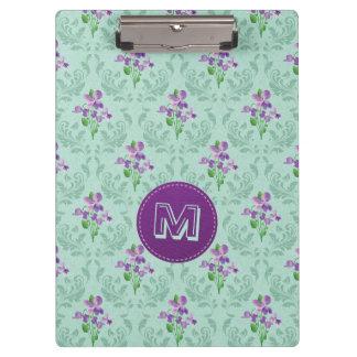 Violettes und tadelloses grünes Retro Blumen Klemmbrett