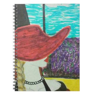 Vorbildliches Reisen des roten Hutes mit dem Zug Spiral Notizblock