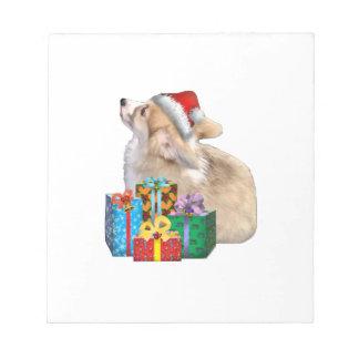 Walisercorgi-Welpe mit Weihnachtsmannmütze Notizblock