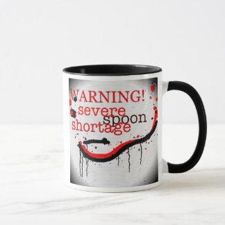 warnende Tasse des Löffelmangels