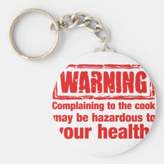 Warnung - die Beschwerde zum Koch kann gefährlich Schlüsselbänder