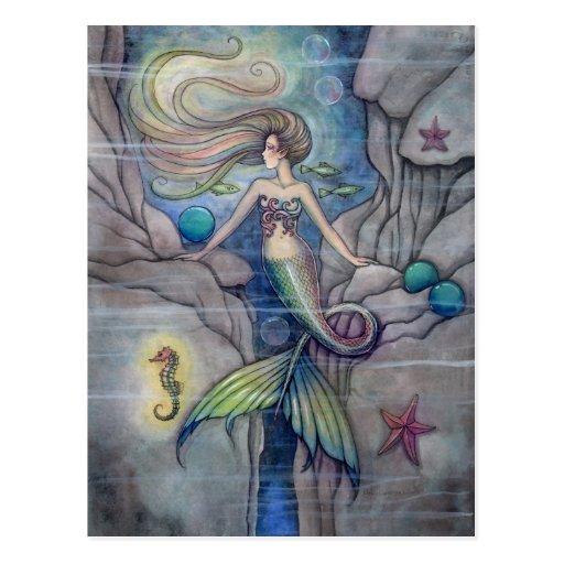 Was unter Meerjungfrau-und Seepferd-Postkarte lieg