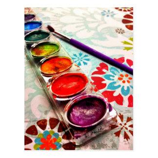 Watercolor-Künstler-Farben-Behälter und Bürste auf Postkarte