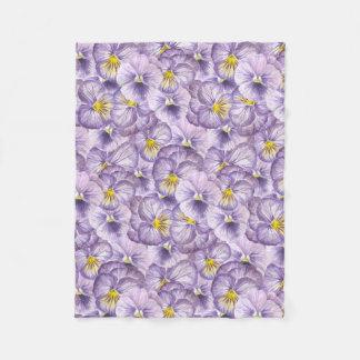Watercolorblumenmuster mit violettem fleecedecke