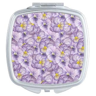 Watercolorblumenmuster mit violettem taschenspiegel