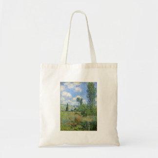 Weg auf den Mohnblumen-Gebieten - Claude Monet Tragetasche