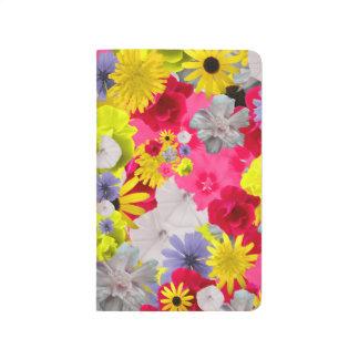 Weibliche Blumen in den schönen blühenden Farben Taschennotizbuch