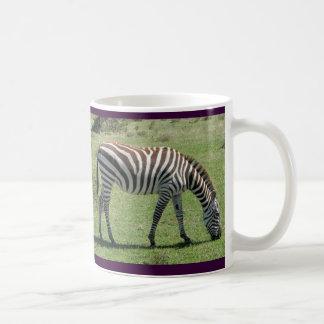 Weiden lassen des Zebra, der Zebra weiden lässt Kaffeetasse
