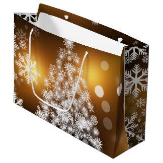 Weihnachtengoldener Bokeh Schneeflocke-Baum Große Geschenktüte
