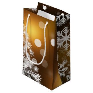 Weihnachtengoldener Bokeh Schneeflocke-Baum Kleine Geschenktüte
