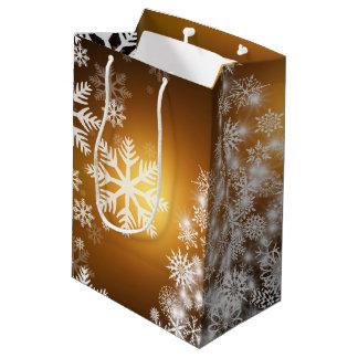 Weihnachtengoldener Bokeh Schneeflocke-Baum Mittlere Geschenktüte
