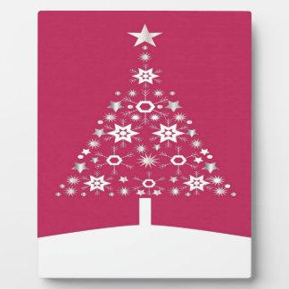 Weihnachtsbaum gemacht von den Schneeflocken auf Fotoplatte