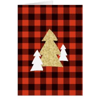 Weihnachtsbäume auf roter karierter karte