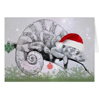 Weihnachtschamäleon in einer Weihnachtsmannmütze Grußkarte