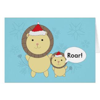 Weihnachtslöwen, die Weihnachtsmannmützen tragen Grußkarte