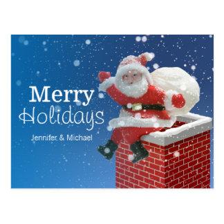 Weihnachtsmann, der auf Kamin sitzt Postkarte