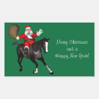 Weihnachtsmann, der ein schwarzes Pferd reitet Rechteckiger Aufkleber