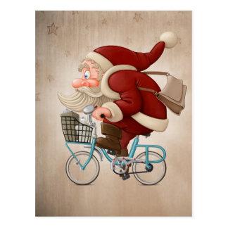 Weihnachtsmann fährt Fahrrad Postkarte